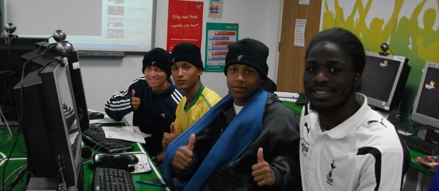 Local community volunteer Lanre Popoola (right) with Brazilian youth visting White Hart Lane from Premier Skills