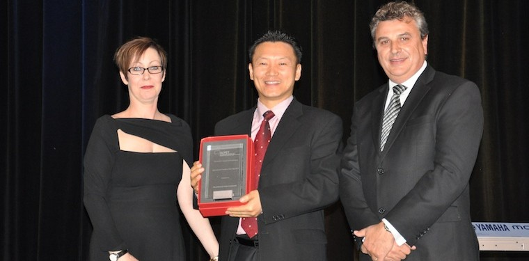 Min Park (centre) of Academia International accepting the ACPET award for International Provider of the Year